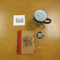 notebook, pins, mug